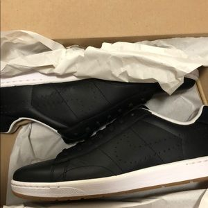 Nike Shoes - Black Nike sneakers - never worn; still in box